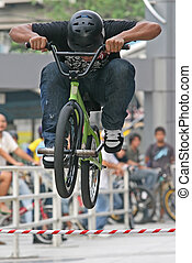 BMX Jump - A BMX competitor performs a jump during an event
