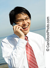 Businessman - A businessman talking on the phone at the...