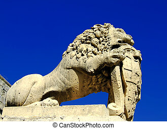 Stone Lion - Medieval stone sculpture of lion guarding the...