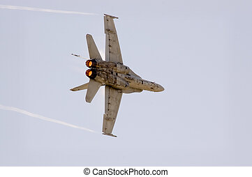 Turning - An F18 Hornet turning at very high speed