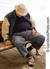 Nap - A heavy older gentleman who has fallen asleep on a...