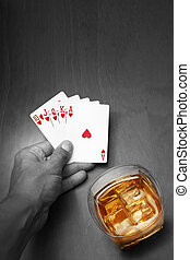 Poker Noir - Poker player with cards and whiskey in color