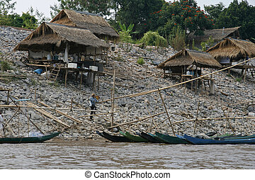Fishermans village on the shore of the Mekong River, Golden...