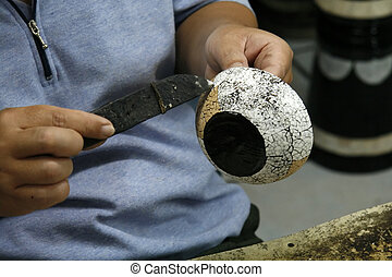 Working at lacquer factory - A worker is making an eggshell...