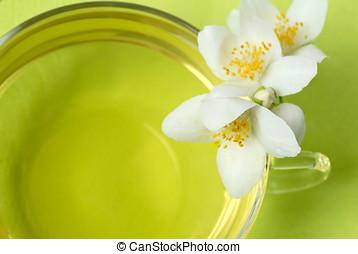 Jasmine tea - Macro of jasmine tea and blossoms