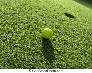 Yellow ball - A yellow ball on the green at the 18th hole.