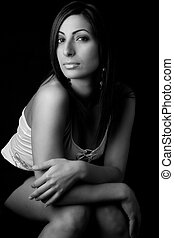 Fashion model - Sitting - Black and white photo of a twenty...