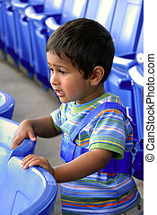 Engrossed - An young Indian kid engossed at a theatre