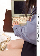 Communication - Details of woman\\\'s body with a laptop on...