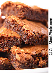 Stack of brownies - Pile of moist brownies piled high on...