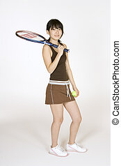 Tennis - Model Release 302 Asian teen holding a tennis...