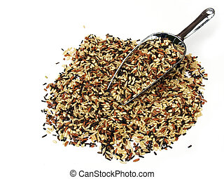 scoop with wild and brown rice - A metal scoop with brown...
