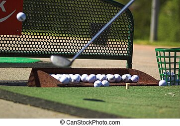 Golf Ball Hit - A golf ball has just been hit by a club and...