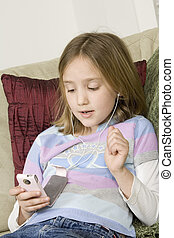 Teenager - Model Release 299 Preteen girl listening to iPod