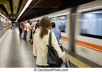 Rome - Passengrs get ready to ride the subway in Rome,...