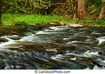 River - Beautiful landscape of a river flowing over rocks in...