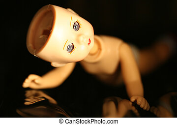 Broken Doll - Close up of a doll with missing parts with a...