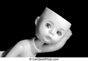 High Contrast Doll - Close up of a doll with missing parts...