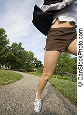 jogging - Model Release 350 Young woman in early 20s jogging...
