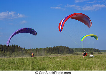 three colour paraglide