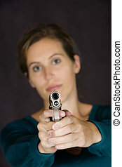Gun - Model Release 353 Woman defending herself with handgun