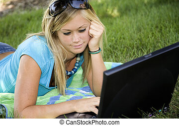 Teen - Model Release 358 Teenage girl working on laptop...