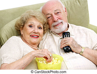 Ready to Relax - A happy senior couple with the remote...