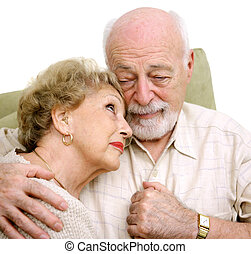 Grieving Together - An elderly husband and wife consoling...