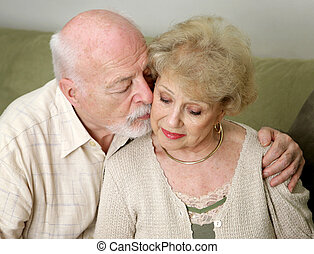 Comforting Her - A senior man and wife deeply in love She is...