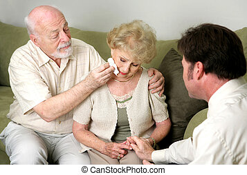 Drying Her Tears - A senior couple with a counselor or...