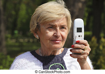 Senior woman with phone - Senior woman using a mobile...