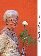 Happy senior woman - Portrait of a happy senior woman with a...