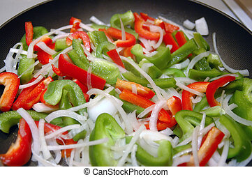Vegetable Stir-Fry - Close-up shot of red and green peppers...