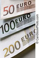 biljets - closeup of a 50, 100 and 200 eurobiljet