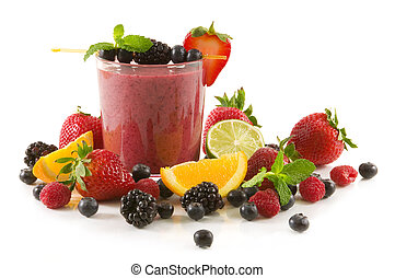 Berry smoothie - A glass of berry smoothie surrounded by...