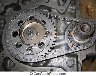 engine timing chain - close up of an 8 cylinder timing gear...