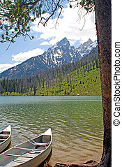 Canoes on lake - Two canoes resting on shore of String lake...