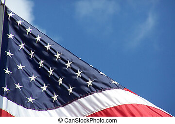 Old Glory - Close-up of American flag against a blue sky.