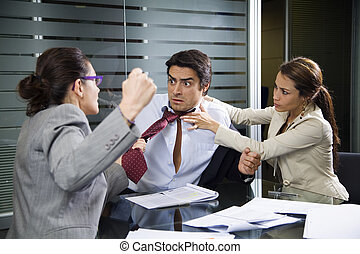 business team  - Office life: business team having a fight