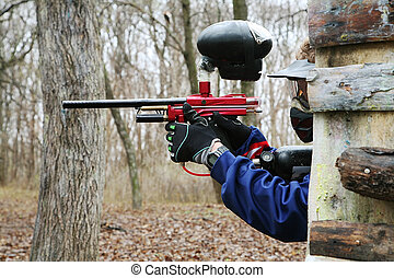 paintball - Gun and mask for game in a paintball
