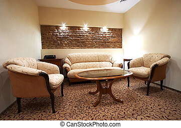 Sofa and two armchairs in modern hotel