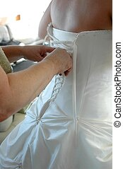 Lacing up Bridal Gown - A mom helping her daughter lace up...