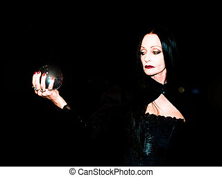 Crystal ball held in the hands of a fortune teller.