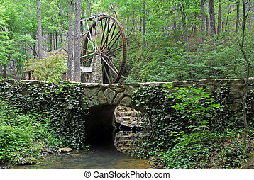 Old Grinding Mill - 1930 water wheel grinding mill in a...