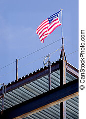 Flag - A United States flag raised by iron workers atop the...