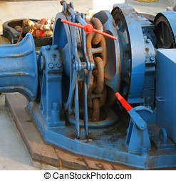Anchor Winch - -- large piece of equipment on board a ship...