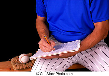 Baseball Player - Baseball player sitting on bench keeping...