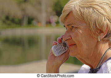 Senior woman with phone - Profile of a senior woman using a...