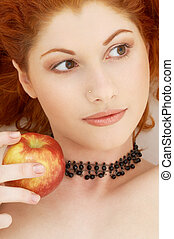 lovely redhead with delicious apple