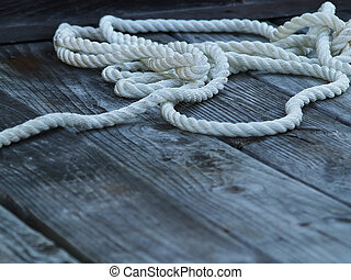 Roped In - Closeup of a nylon rope laying on a weathered...